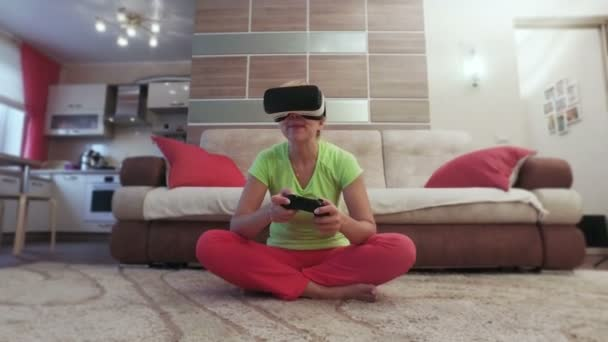 Beautiful woman with virtual reality helmet are playing computer console game front view
