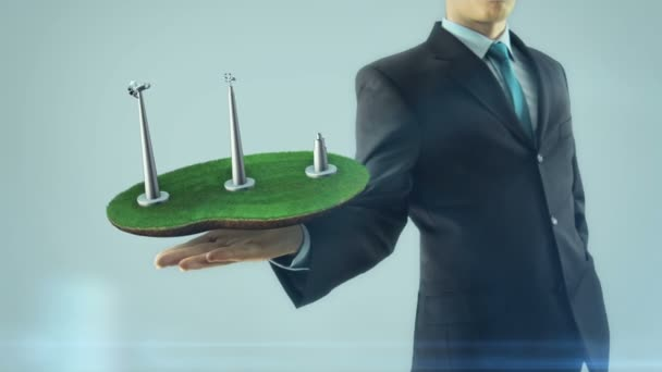 Business man has on hand green energy concept build animation windmill