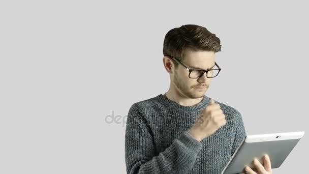 Clever hipster creative man think touch digital tablet ipad gets an idea, which jumps up as symbolic colored cartoon animation shape lamps around him on white background