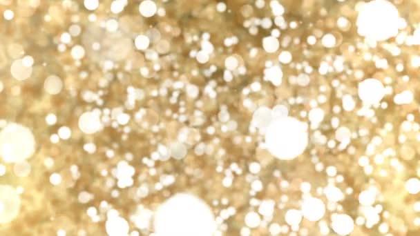 Zlatá abstraktní Bokeh světla částic smyčky pozadí