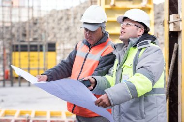 Civil Engineer And Foreman At Construction Site
