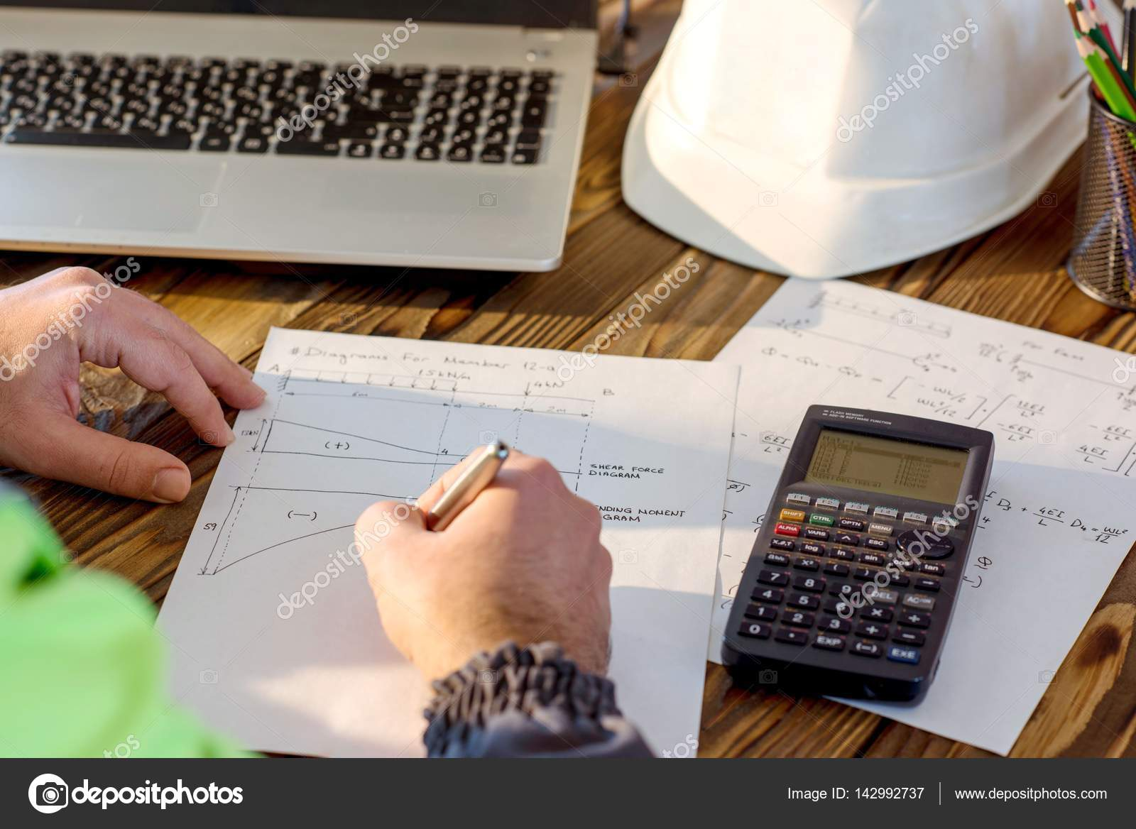 Civil Engineer making Structural Analysis Calculations