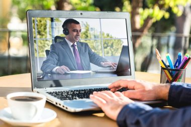 Man Having Online Meeting With His Business Partner