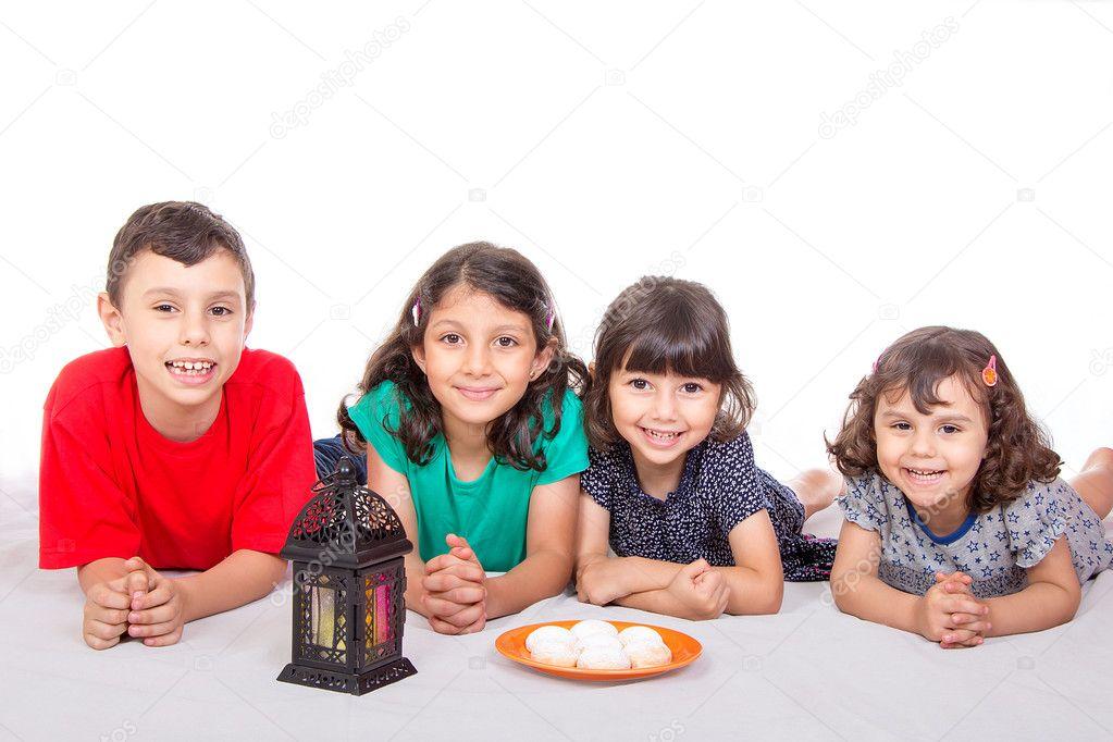 Amazing Child Eid Al-Fitr Feast - depositphotos_128361914-stock-photo-happy-kids-celebrating-eid-el  Best Photo Reference_653317 .jpg