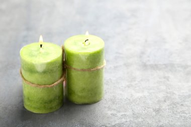 Burning green candles