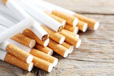 Tobacco cigarettes on table