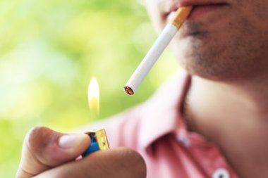 Man  lighting up cigarette