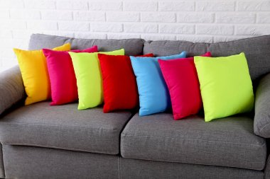 Colorful pillows on  background