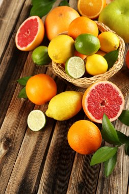 Citrus fruits on wooden table