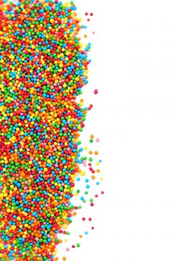 Colorful sprinkles on a white