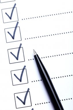 Check boxes with ballpoint pen