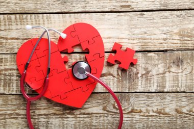 Red puzzle heart with stethoscope