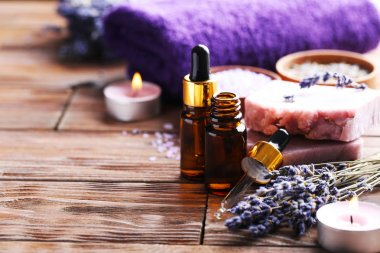 Lavender oil with soap and flowers
