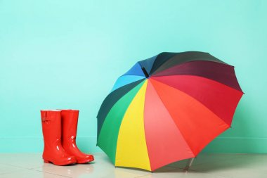 Red boots with umbrella