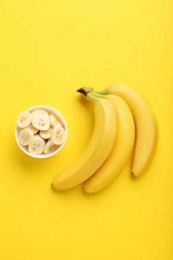 Sweet bananas with cuted pieces in bowl