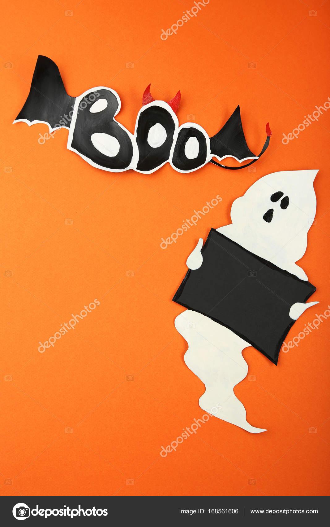 Halloween ghost on orange background — Stock Photo