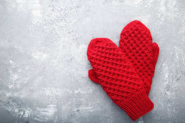 Knitted red gloves