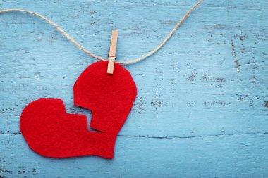 Broken red heart hanging