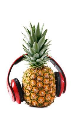 Ripe pineapple with headphones
