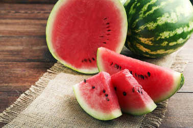 Slices of watermelons on table