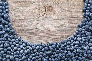 Ripe blueberries on grey