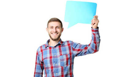 Young man holding speech bubble