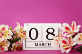 Calendar cubes with flowers on pink background