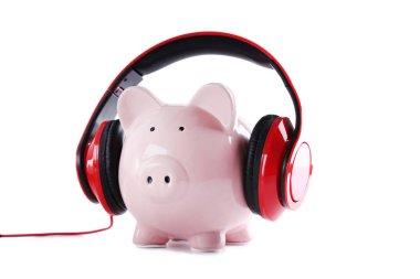 Headphones on piggybank isolated on white