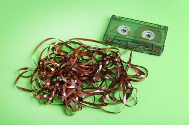 Old cassette tapes on green background