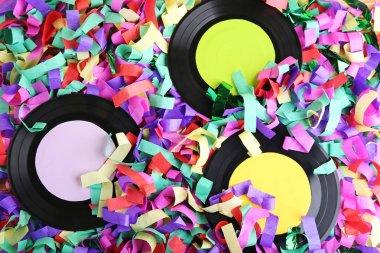 Vinyl records on colourful confetti