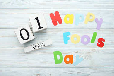 Calendar cubes with inscription Happy Fools Day on wooden table