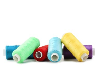 Colourful thread spools isolated on a white stock vector