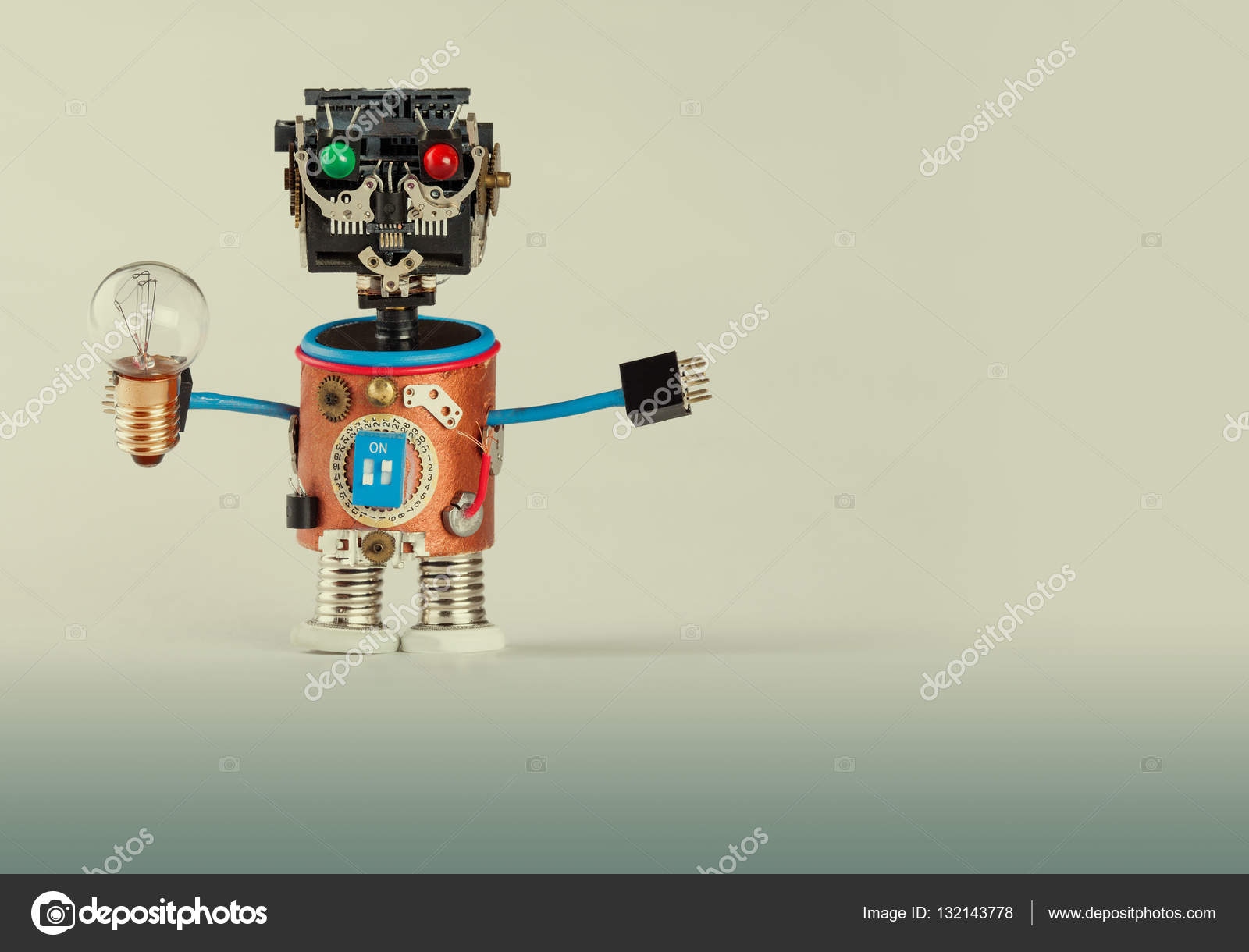 Retro style robot with light bulb. Plastic head, colored green red ...