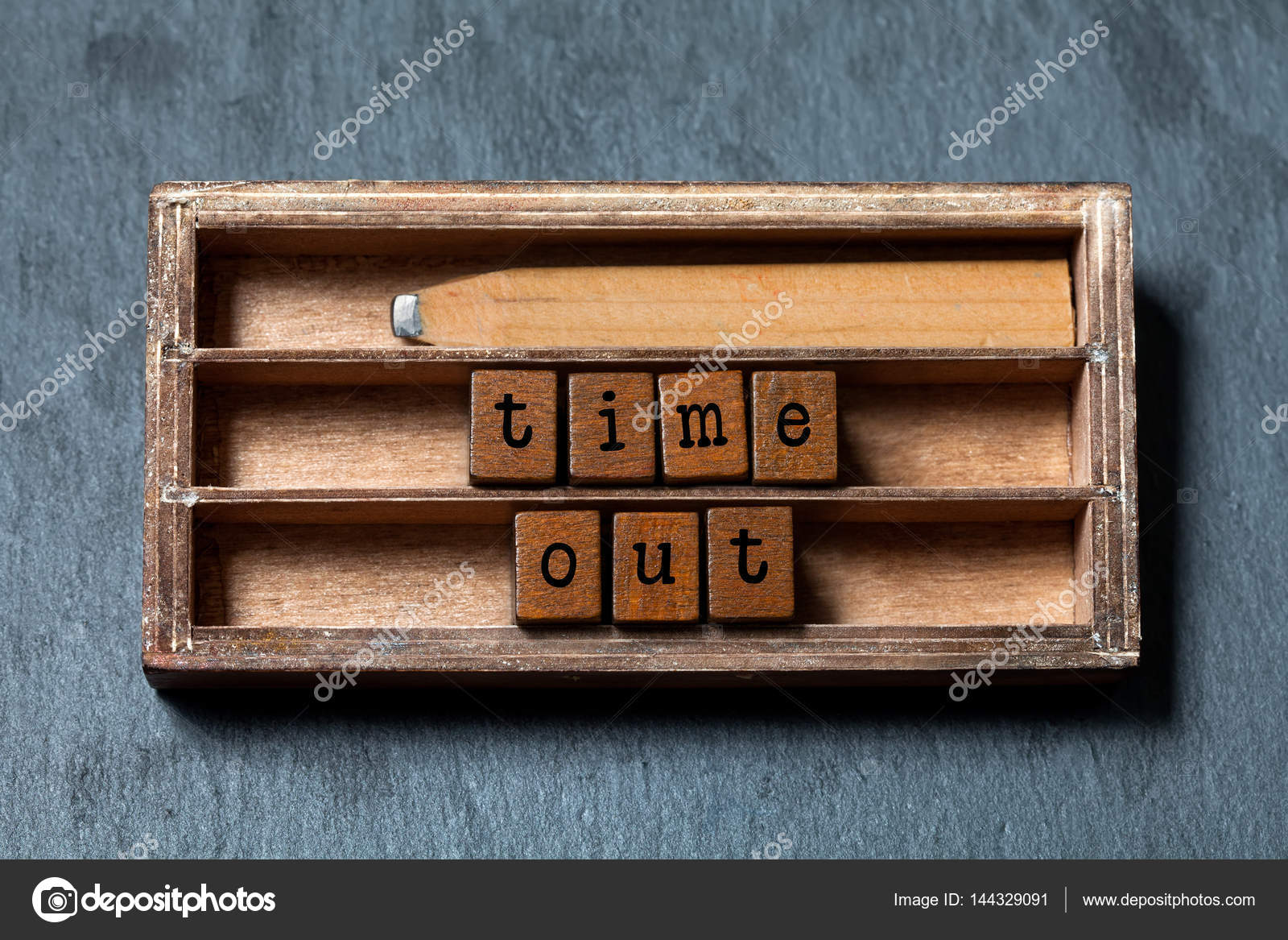 Time out concept. Vintage box, wooden cubes with old style letters ...