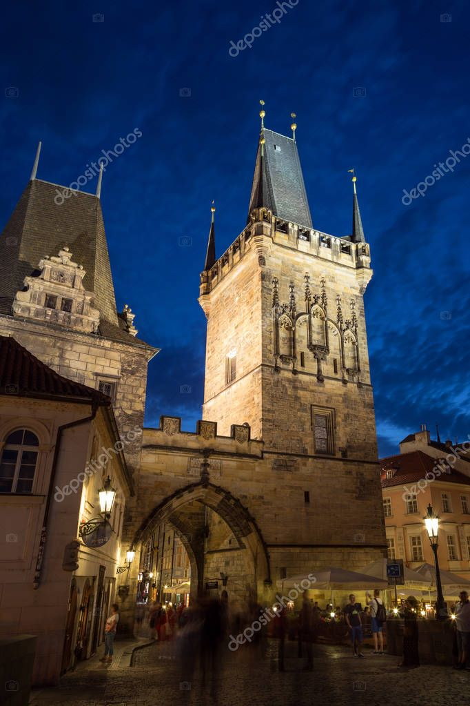 Фотообои Tower and people in Prague at dusk