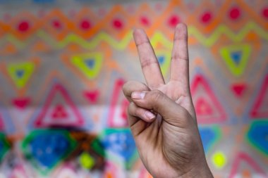 Human hand making symbols