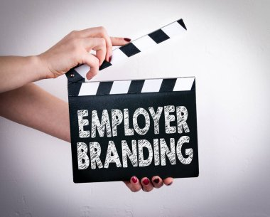 Employer Branding. Female hands holding movie clapper