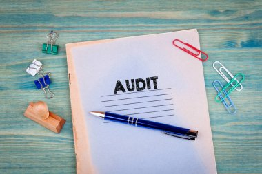 audit concept. Notebook on a bright green background. Office stationery accessories