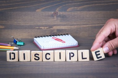 Disciple from wooden letters on wooden background