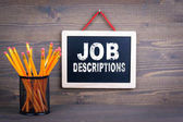 Fotografie Job Descriptions. Career and success concept. Chalkboard on a wooden background