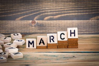 March. Wooden letters on the office desk, informative and communication background