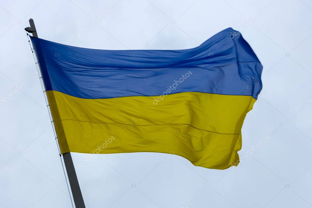 ukrainian national flag against the blue sky