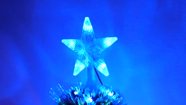 beautiful christmas star shining on christmas tree. New Year 2020 mood. Christmas tree, happy holidays. Christmas interior. holiday for children and adults.