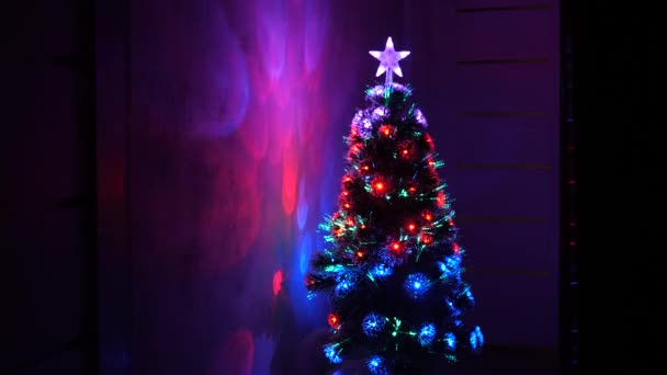 New Year 2020 mood. Christmas tree, happy holidays. Christmas interior. beautiful Christmas tree in room, decorated with a luminous garland and a star. holiday for children and adults.