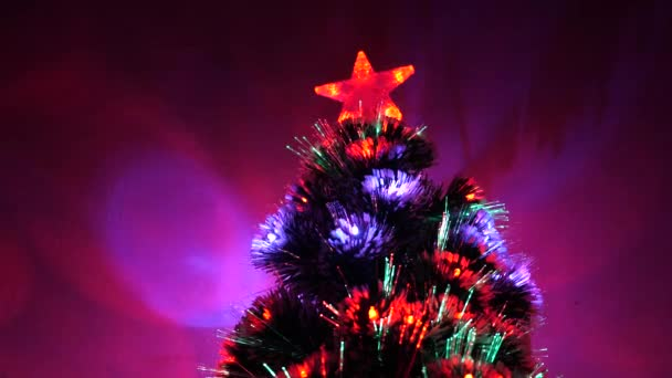 Christmas tree, happy holidays. Christmas interior. beautiful Christmas tree in room, decorated with a luminous garland and a star. holiday for children and adults. New Year 2020 mood.
