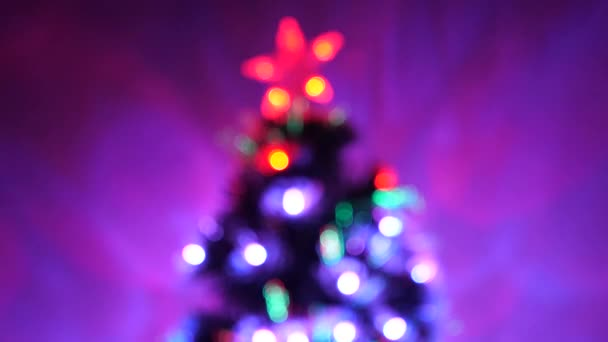 Christmas tree, happy holidays. multi-colored bokeh of a New Year tree in the room, decorated with luminous garland and a star. holiday for children and adults. New Year. Christmas interior.