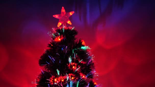 New Year .Christmas tree, happy holidays. Christmas interior. beautiful Christmas tree in room, decorated with a luminous garland and a star. holiday for children and adults.