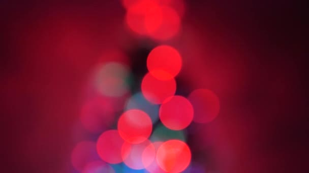 beautiful multi-colored bokeh of a Christmas tree in room, decorated with a luminous garland and a star. holiday for children and adults. New Year. Christmas tree, happy holidays. Christmas interior.