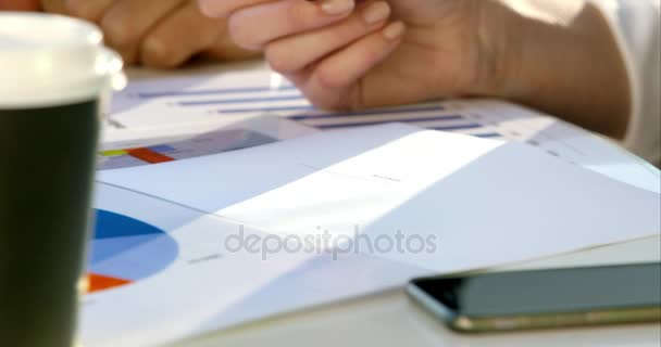 businessman writing notes during meeting