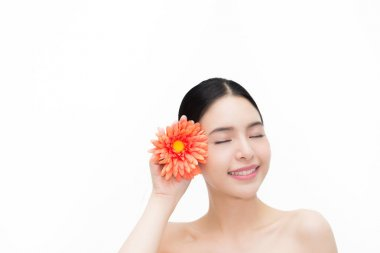 Young beauty Asian face with flower, beautiful woman isolated over white background. Healthcare and Skincare concept